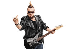 Rude punk rocker holding guitar Stock Photography