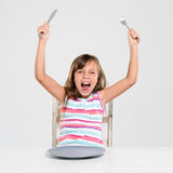 Rude screaming child at dinner Royalty Free Stock Image