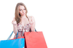 Rude young shopping female showing both middle fingers Stock Image