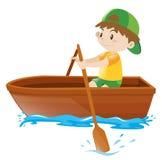 Ruderboot des kleinen Jungen allein Stockbild