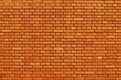 Rudości pomarańcze ściana z cegieł barwiony tło Zdjęcia Stock