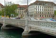 Rudolf Brun bridge - Zurich. A tourist takes a photo from the Rudolf Brun bridge (brucke) named after the leader of the guilds' revolution of 1336 Royalty Free Stock Image
