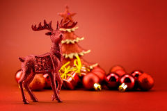 Rudolf near christmas tree Royalty Free Stock Photo