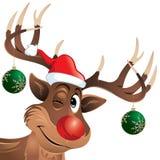 Rudolph ο τάρανδος που κλείνει το μάτι με τις σφαίρες Χριστουγέννων Στοκ Φωτογραφία