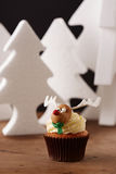 Rudolph cupcake on Christmas background Royalty Free Stock Photography