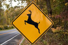 Rudolph the red nosed reindeer crossing road sign Royalty Free Stock Photo