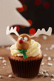 Rudolph reindeer cupcake on Christmas background Stock Photo