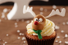 Rudolph reindeer cupcake on Christmas background Royalty Free Stock Images