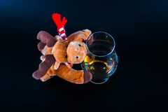 Rudolph reindeer with a single malt whiskey glass, symbol of Chr Stock Photo