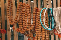 Rudraksha beads and rosary. Hindu sacred attribute for prayers. Rudraksha is used in necklaces and jewelry. Rudraksha beads and rosary. Hindu religious sacred stock images