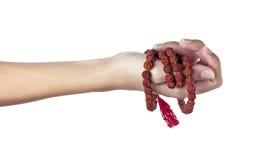 Rudraksha rosary in a female hand. Japa mala Royalty Free Stock Photography