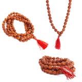 Rudraksha rosary in a female hand. Japa mala. Royalty Free Stock Photos