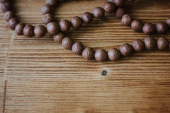 Rudraksha rosary on wooden background. Stock Photo