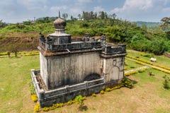 Rudrapa mausoleum at domain Raja Tombs, Madikeri India. Madikeri, India - October 31, 2013: Closeup on small white and gray Guru Rudrappa mausoleum with bull Royalty Free Stock Images