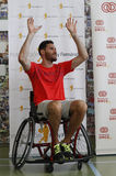 Rudy Fernandez charity event. Spain basketball player, and former NBA, Rudy Fernandez gestures on a wheelchair during a charity event promoted by his fundation Royalty Free Stock Photo