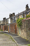 Rue arrière de cottages en terrasse en pierre Image stock