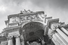 Rue Augusta arch in Commerce in Lisbon. Rue Augusta arch in Commerce. Lisboa, Portugal. On the arch the sculptures of Viriatus, Vasco da Gama, Pombal and Nuno Royalty Free Stock Images