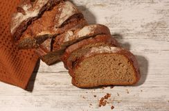 Rue bread on the table. Delicious rye bread on the table stock photography