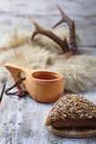 Rue bun with seeds and finnish cup kuksa Stock Image