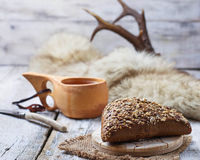 Rue bun with seeds and finnish cup kuksa Stock Images