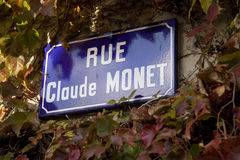 Rue Claude Monet. Old-fashioned sign in Giverny, home of the impressionist master Royalty Free Stock Images