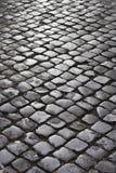 Rue de pavé rond à Rome, Italie. Photographie stock libre de droits