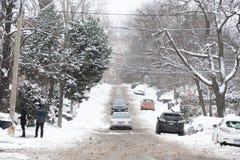 Rue détrempée par la neige Photographie stock