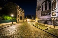 Rue du Chevalier de la Barre and Sacré-Cœur at night, in Paris Royalty Free Stock Photo