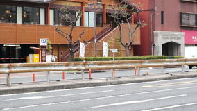Rue du trafic en général en Osaka Japan banque de vidéos