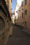 Rue Frédéric Isnard, Antibes, France. Rue Frédéric Isnard street in Antibes old town. Antibes is a Mediterranean resort in the Alpes-Maritimes Stock Photo