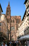 Rue Merciere and view of west facade of Cathedral. STRASBOURG, FRANCE - JULY 10, 2010: people on street Rue Merciere and view of west facade of Strasbourg Royalty Free Stock Image