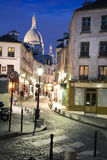Rue Norvins and Sacré-Coeur in Paris,France. The little Rue Norvins on Montmartre Hill, France, that is full of souvenirs shops. Sacré-Coeur Basilica in royalty free stock images