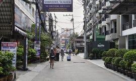 Rue Soi 10 Les gens vont sur des affaires, véhicules mobiles Photo stock