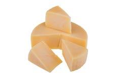 Rueda amarilla del queso aislada en el fondo blanco Imagen de archivo