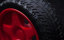 Rueda de coche roja del juguete Imagen de archivo