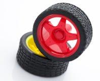 Rueda de coche roja y amarilla del juguete Foto de archivo libre de regalías