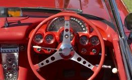 Rueda roja de Steeering del coche Imágenes de archivo libres de regalías