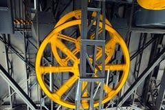 Ruedas amarillas del cablecarril Imagenes de archivo
