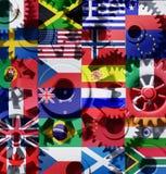 Ruedas internacionales de los dientes del mundo de la economía Foto de archivo libre de regalías