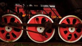 Ruedas rojas del tren Foto de archivo