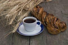 Ruede con la amapola, el café y oídos de trigo Foto de archivo