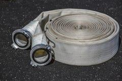 Ruede una manguera de bomberos Fotografía de archivo