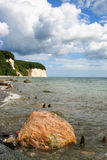 Ruegen island beach with Baltic sea and chalk cliffs in the background Royalty Free Stock Images