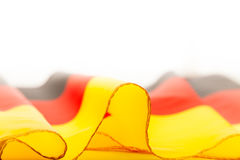 Ruffled flag of Germany laying on flatness Stock Images
