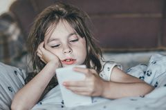 Ruffled girl in the morning. Shaggy sleepy offended child in the morning Stock Photos