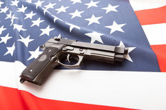 Ruffled national flag with hand gun over it series - United States Royalty Free Stock Image