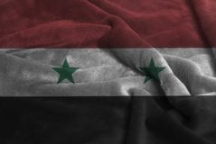 Ruffled Waving Flag of Syria stock images