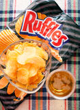 Ruffles and beer editorial Royalty Free Stock Image