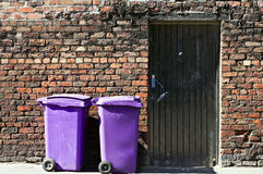 Rufuse bins. Against old brick wall Royalty Free Stock Image