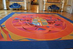 Rug with Coat of Arms in a Royal Palace Stock Photo
